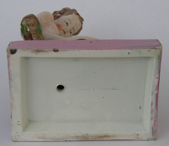 Creamware WOOD & CALDWELL Saffordshire figure of a boy bottom view
