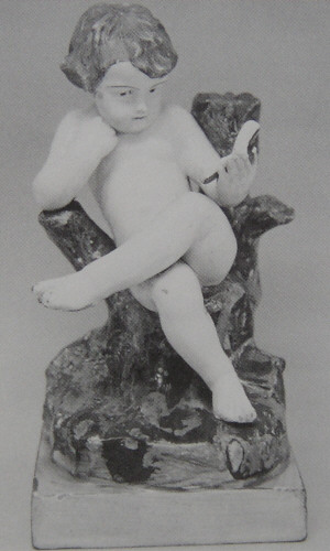 Staffordshire figure of a boy reading made by Wood and Caldwell 1790-1818