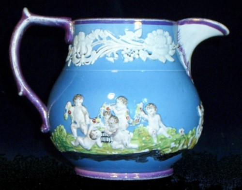 Jug made by Wood and Caldwell Staffordshire Pottery 1791-1818 side view purple blue green white
